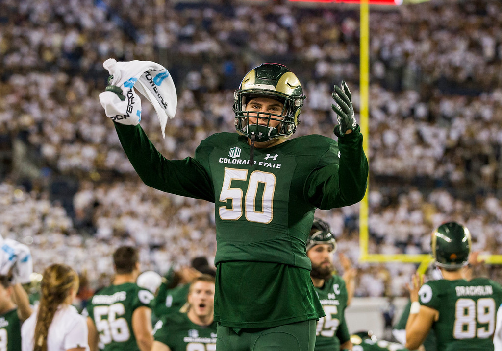 . Colorado State linebacker COrte Tapia (50) rallies Ram\'s fans during the Rocky Mountain Showdown Friday evening August 31, 2018 at Sports Authority Field in Denver. (Michael Brian/For the Reporter-Herald)