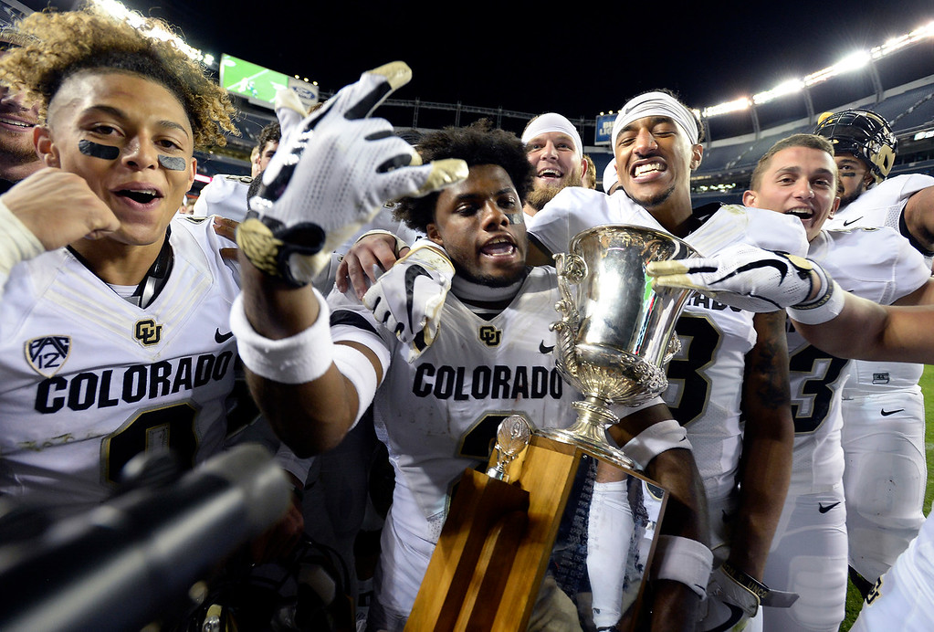 . DENVER, CO: August 31: Aaron Maddox, left, Ronnie Blackmon, left, and Derrion Rakestraw, celebrate the win with the Centennial Cup on August 31, 2018 at Bronco Stadium at Mile High. (photo by Cliff Grassmick/Staff Photographer).