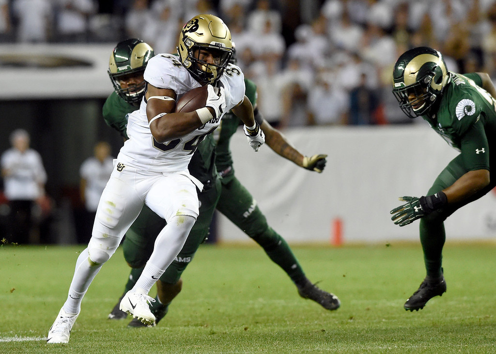 . DENVER, CO - AUGUST 31, 2018: University of Colorado\'s Travon McMillian runs the ball for big yardage during the Rocky Mountain Showdown football game against Colorado State University on Friday at Bronco\'s Stadium at Mile High in Denver. More photos: BoCoPreps.com (Photo by Jeremy Papasso/Staff Photographer)