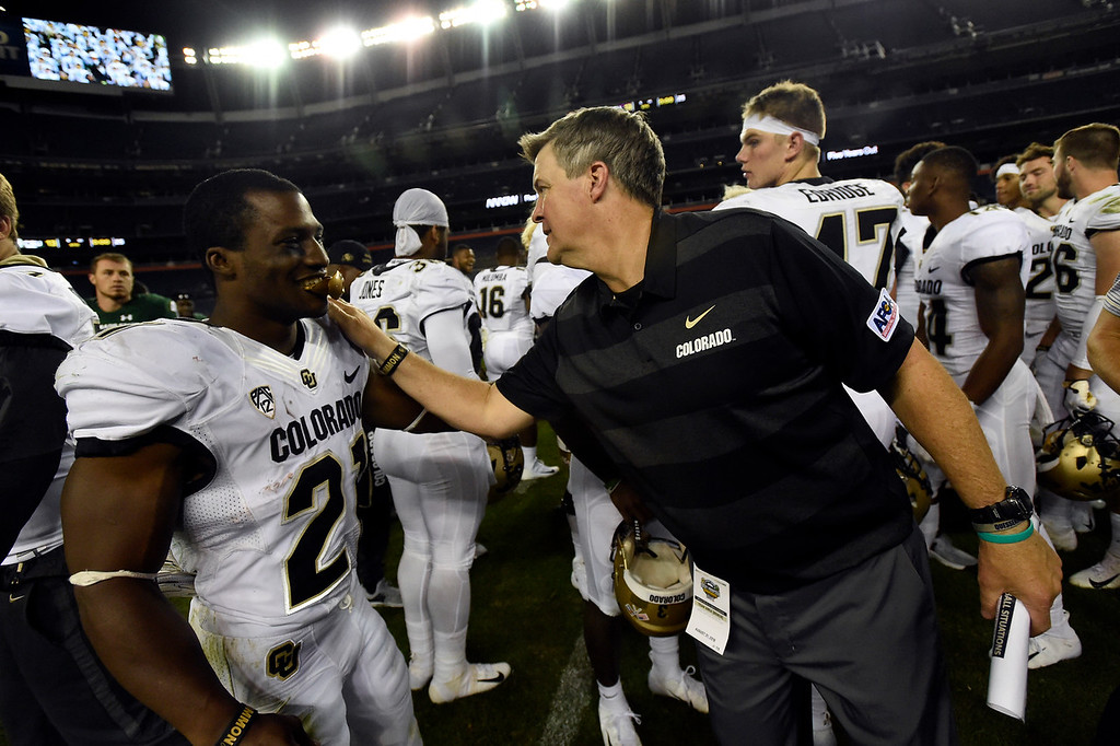 . DENVER, CO - AUGUST 31, 2018: University of Colorado Head Coach Mike MacIntyre congratulates Kyle Evans after defeating Colorado State during the Rocky Mountain Showdown football game on Friday at Bronco\'s Stadium at Mile High in Denver. More photos: BoCoPreps.com (Photo by Jeremy Papasso/Staff Photographer)