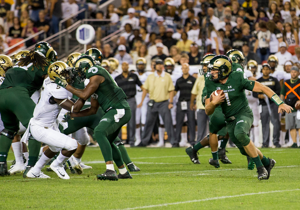 . Colorado State quarterback K.J. Carta-Samuels (1) takes off with the football during the Rocky Mountain Showdown Friday evening August 31, 2018 at Sports Authority Field in Denver. (Michael Brian/For the Reporter-Herald)