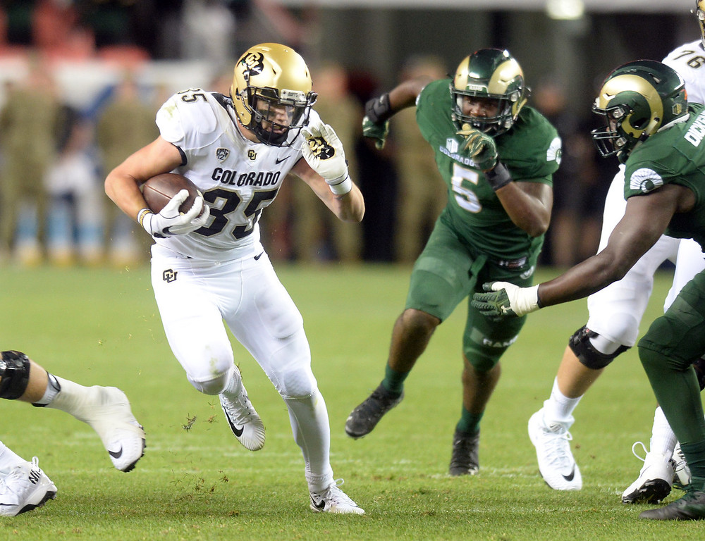 . DENVER, CO: August 31: Beau Bisharat, of CU, breaks away on a long run during the second half on August 31, 2018 at Bronco Stadium at Mile High. (photo by Cliff Grassmick/Staff Photographer).