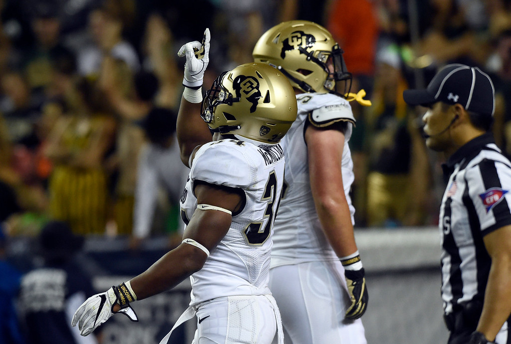 . DENVER, CO - AUGUST 31, 2018: University of Colorado\'s Travon McMillian celebrates a touchdown during the Rocky Mountain Showdown football game against Colorado State University on Friday at Bronco\'s Stadium at Mile High in Denver. More photos: BoCoPreps.com (Photo by Jeremy Papasso/Staff Photographer)