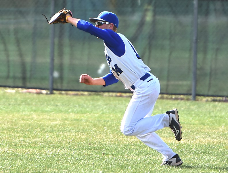 Hayden Van De Pol runs down a fly ball in right field during the Broomfield Eagles' game against Rocky Mountain on Thursday, April 12, at Broomfield High School.