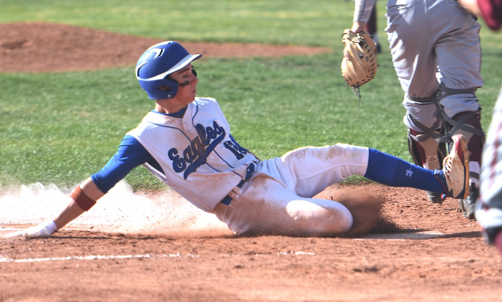 . Broomfield\'s Trenton Harris slides into home plate during the Eagles\' game against Rocky Mountain on Thursday, April 12, at Broomfield High School.