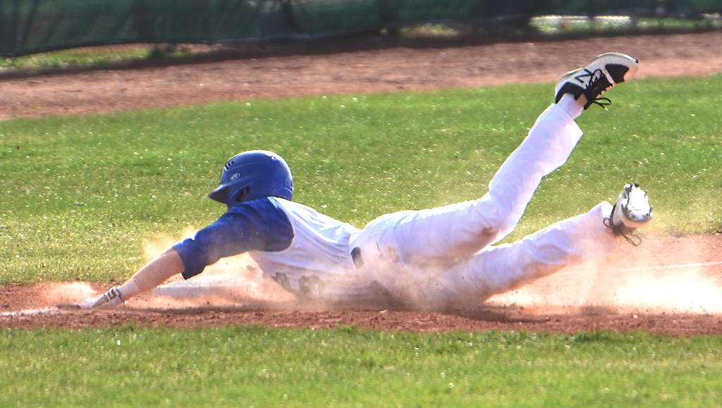 . Broomfield\'s Ben Peterson slides into third base during the Eagles\' game against Rocky Mountain on Thursday, April 12, at Broomfield High School.
