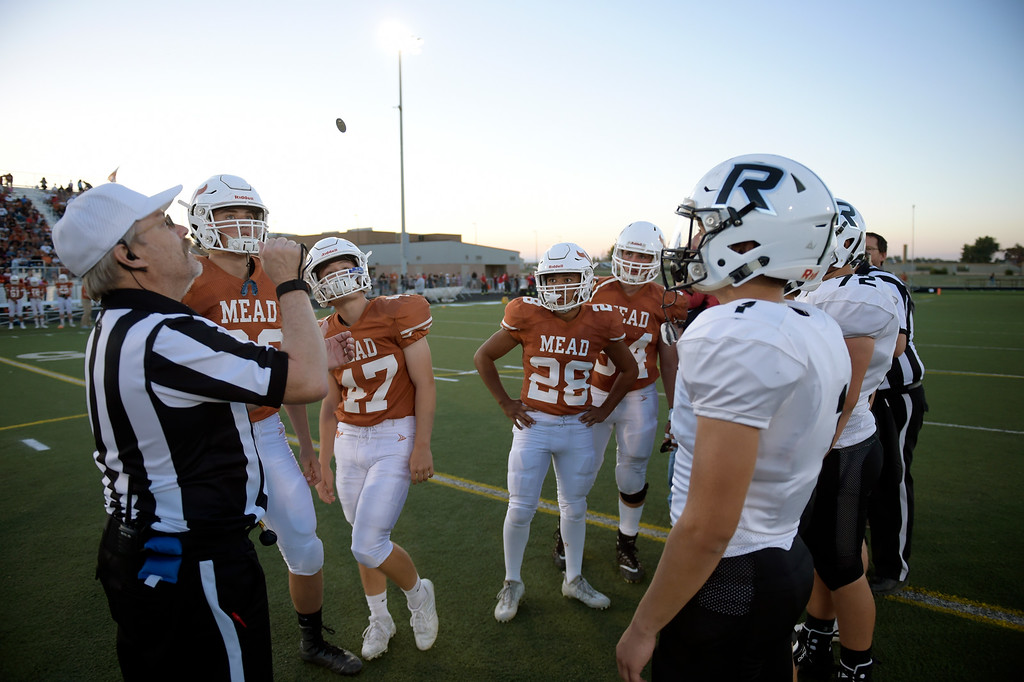 . MEAD, CO - SEPTEMBER 14, 2018: Mead and Roosevelt captains meet for the coin toss at the start of their game at Mead High School Sep. 14. (Photo by Lewis Geyer/Staff Photographer)