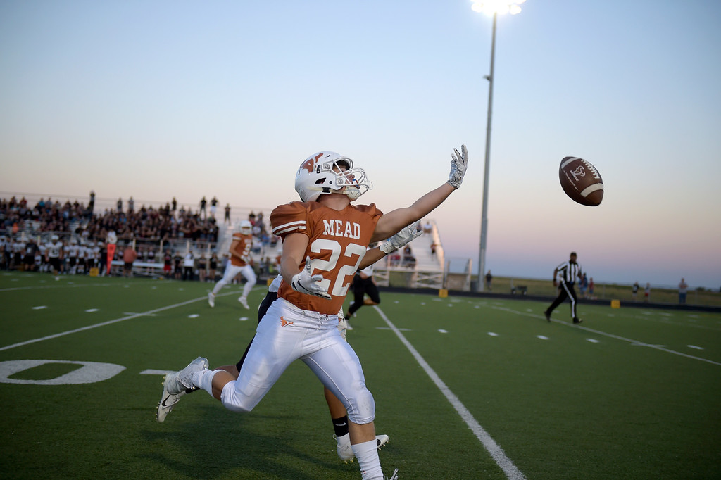 . MEAD, CO - SEPTEMBER 14, 2018: A pass to Mead\'s Caleb Domenico misses its target in the first quarter against Roosevelt at Mead High School Sep. 14. (Photo by Lewis Geyer/Staff Photographer)