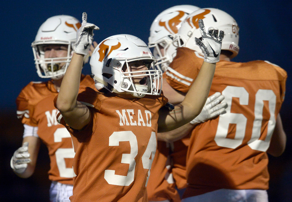 . MEAD, CO - SEPTEMBER 14, 2018: Mead\'s Ryan Bullock celebrates teammate Nathan Bailey\'s touchdown against Roosevelt in the second quarter at Mead High School Sep. 14. (Photo by Lewis Geyer/Staff Photographer)