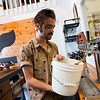 "Thom Spano fills a growler of kombucha for a customer at Rowdy Mermaid Kombucha in Boulder on Wednesday. Rowdy Mermaid Kombucha is the first kombucha maker in the state to get their liquor license. <br /> For more photos go to  <a href=""http://www.dailycamera.com"">http://www.dailycamera.com</a><br /> (Autumn Parry/Staff Photographer)<br /> June 27, 2016"