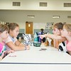 (From left) Olivia Biase, Samantha Swangler, Millie Moffatt, and Brianna Biase play a game of Uno with their stuffed animals: Carrot, Tigress, Tina, and Snuggly.<br /> (Rachel Wisniewski -- For Digital First Media)