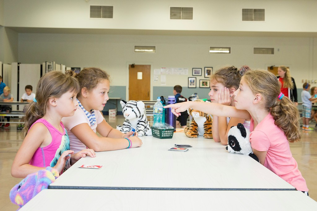 . (From left) Olivia Biase, Samantha Swangler, Millie Moffatt, and Brianna Biase play a game of Uno with their stuffed animals: Carrot, Tigress, Tina, and Snuggly. (Rachel Wisniewski -- For Digital First Media)