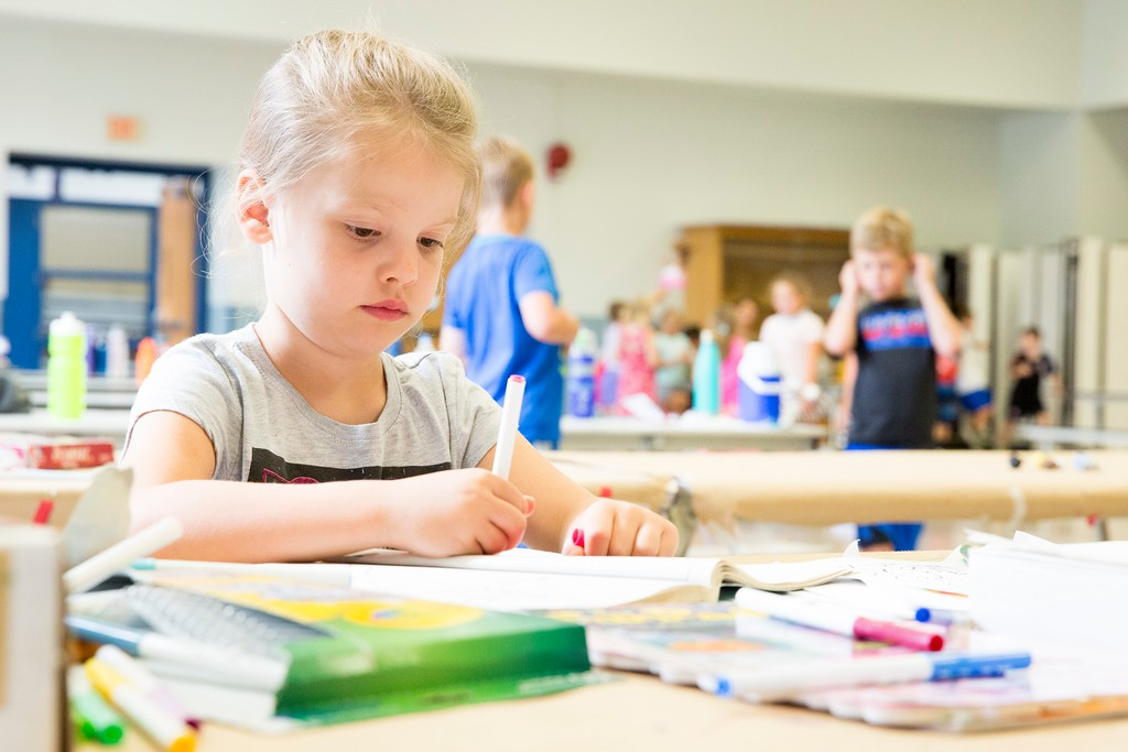 . CJ Beh-Forrest, 6, uses markers to fill in a Mermaid coloring book.  (Rachel Wisniewski -- For Digital First Media)