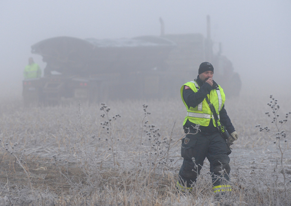 . WELD COUNTY, CO - DECEMBER 4: A semi tractor trailer sits in a field near the scene of a crash involving a St. Vrain Valley School District school bus at the intersection of Colo. 66 and Weld County Road 13 the morning of December 4, 2018. Multiple agencies responded including the Colorado State Patrol, Weld County Sheriff, Firestone Police Department, and Mountain View Fire Rescue. (Photo by Lewis Geyer/Staff Photographer)