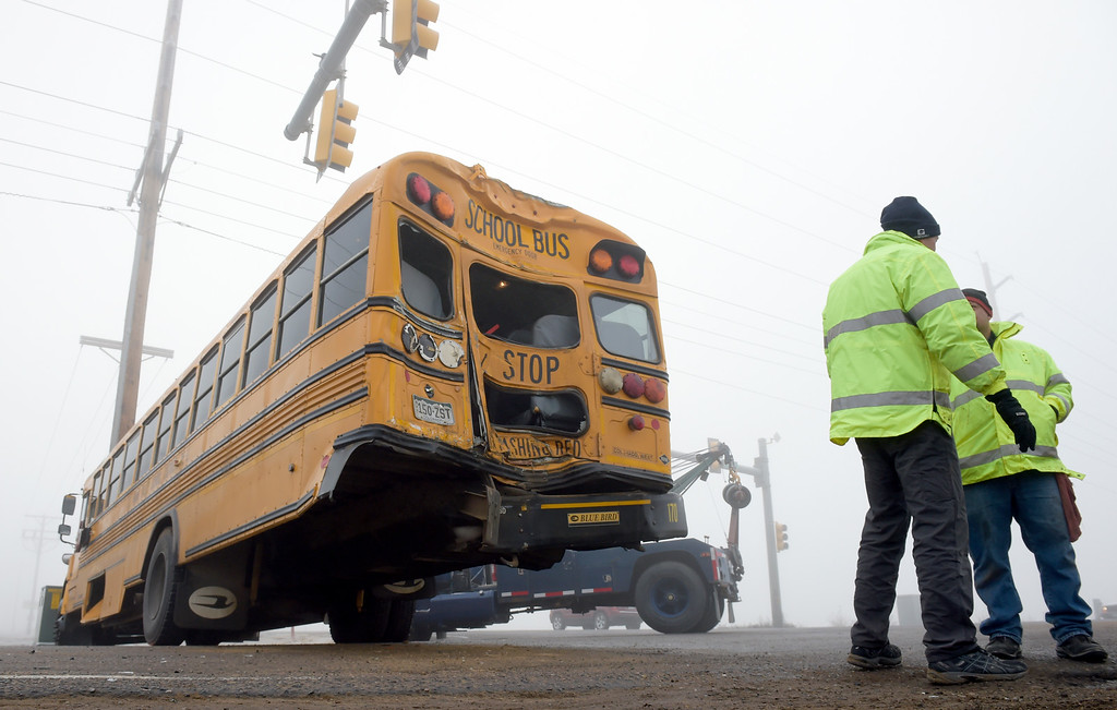 . WELD COUNTY, CO - DECEMBER 4: A St. Vrain Valley School District school bus blocks Weld County Road 13 after it was involved in a crash with a semi tractor trailer at the intersection of Colo. 66 December 4, 2018. Multiple agencies responded including the Colorado State Patrol, Weld County Sheriff, Firestone Police Department, and Mountain View Fire Rescue. (Photo by Lewis Geyer/Staff Photographer)