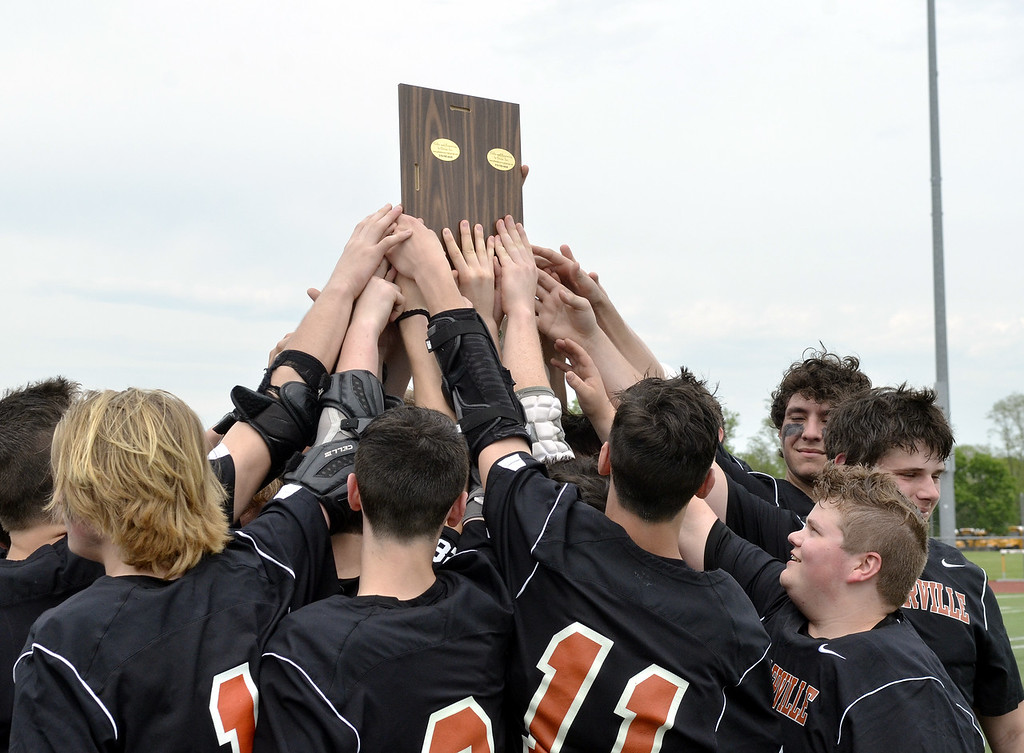 . STAN HUDY - SHUDY@DIGITALFIRSTMEDIA.COMThe Schuylerville boys lacrosse team holds up the championship plaque Saturday afternoon after winning the Section II Class D final at Schuylerville.
