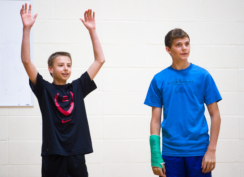 "Nate Kissam (left) and Cole Seifert react to their scooter finishing second place during the race in the aux gym at Lyons Middle/Senior High School on Wednesday. The students built self powered scooters that follow Newton's Third Law of Motion.<br /> More photos:  <a href=""http://www.dailycamera.com"">http://www.dailycamera.com</a><br /> Autumn Parry/Staff Photographer<br /> May 25, 2016"