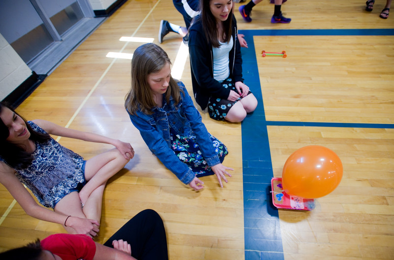 "From left to right, Zoe Johnson, Marrisa Shaw and Ashlee Clark watch their scooter take off during the race in the aux gym at Lyons Middle/Senior High School on Wednesday. The students built self powered scooters that follow Newton's Third Law of Motion.<br /> More photos:  <a href=""http://www.dailycamera.com"">http://www.dailycamera.com</a><br /> Autumn Parry/Staff Photographer<br /> May 25, 2016"