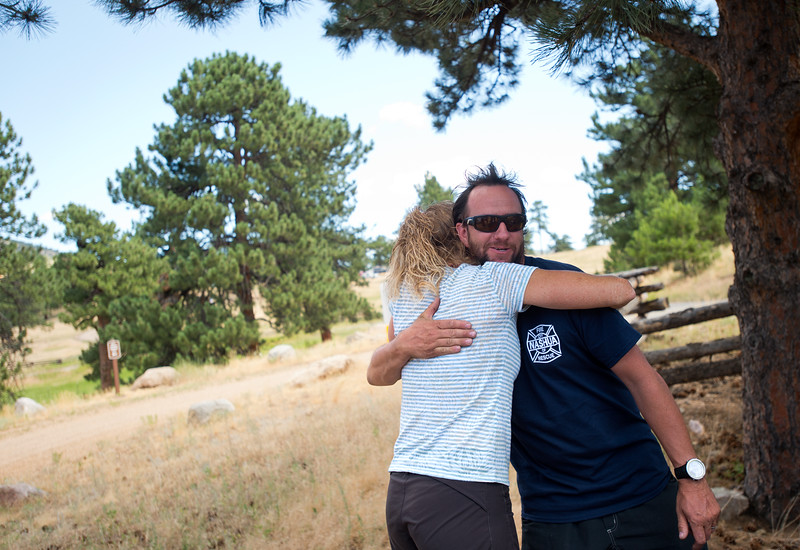 "Charlie Schmidtmann receives a hug from Michelle Grainger as the search party gathers at Betasso Preserve on Saturday to look for Geno, Schmidtmann's St. Bernard who went missing during the Cold Springs Fire. <br /> More photos:  <a href=""http://www.dailycamera.com"">http://www.dailycamera.com</a><br /> (Autumn Parry/Staff Photographer)<br /> July 23, 2016"