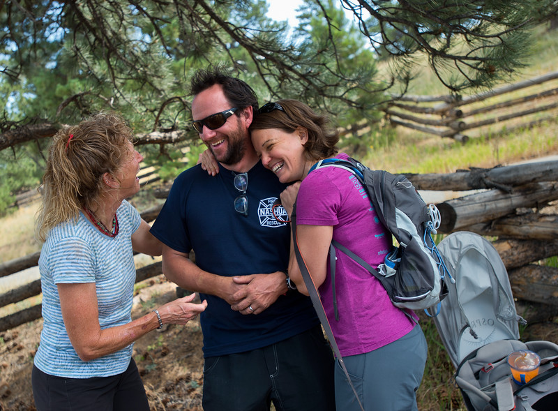 "Michelle Grainger (left) and Kat Barr (right) share a laugh with Charlie Schmidtmann as a search party gathers at Betasso Preserve on Saturday to look for Geno, Schmidtmann's St. Bernard who went missing during the Cold Springs Fire. <br /> More photos:  <a href=""http://www.dailycamera.com"">http://www.dailycamera.com</a><br /> (Autumn Parry/Staff Photographer)<br /> July 23, 2016"