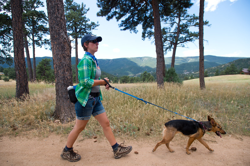 "Amber Erickson Gabbey walks with her dog Moxie as they search for Geno on the Canyon Loop at Betasso Preserve on Saturday. Geno, a St. Bernard belonging to Charlie and Bretlyn Schmidtmann, went missing during the Cold Springs Fire. <br /> More photos:  <a href=""http://www.dailycamera.com"">http://www.dailycamera.com</a><br /> (Autumn Parry/Staff Photographer)<br /> July 23, 2016"
