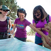 "Kat Barr (center) and Sharon Anderson (right) look at a map to help them determine where they will begin their search for Geno, a St. Bernard belonging to Charlie and Bretlyn Schmidtmann, who went missing during the Cold Springs Fire. <br /> More photos:  <a href=""http://www.dailycamera.com"">http://www.dailycamera.com</a><br /> (Autumn Parry/Staff Photographer)<br /> July 23, 2016"