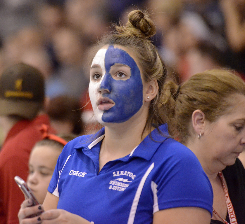 . Saratoga Springs assistant caoch Patnode looks up at the times during Saturday\'s Section 2 Division I finals at Shenendehowa.