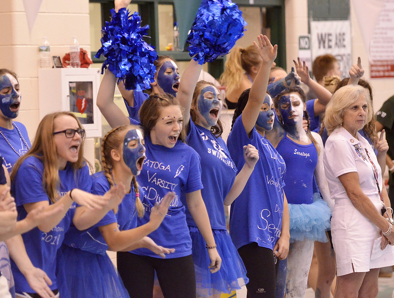 Members of the Saratoga Springs girls swimming and diving team cheer on a teammate during the Section 2 Division I finals at Shenendehowa.