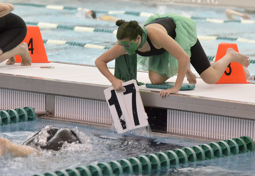 . A Shenendehowa teammate removes the lap counter from the lane during the 500-yard freestyle Saturday afternoon.