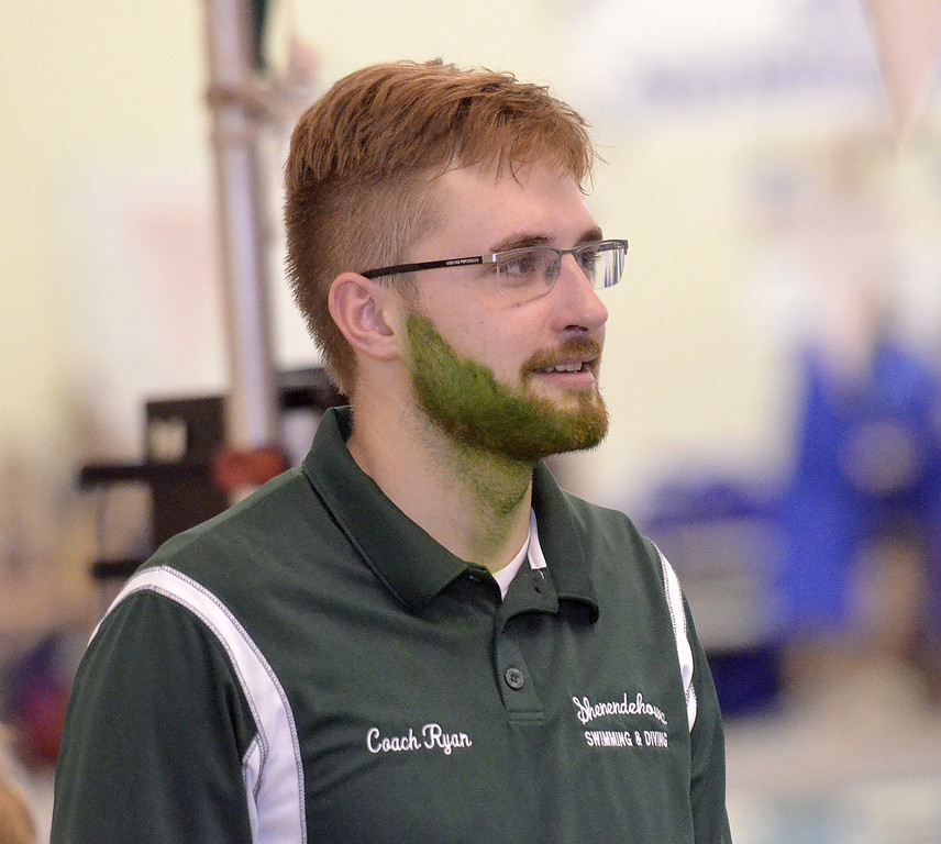 . Green with envy? Shenendehowa assistant swimming coach Ryan Gordon looks at warm-ups during the Section 2 Division I championships Saturday.