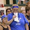 Shaker High School swim coach Maggie Callesano looks up anxiously at the scoreboard during the Section 2 Division I championship meet at Shenendehowa.