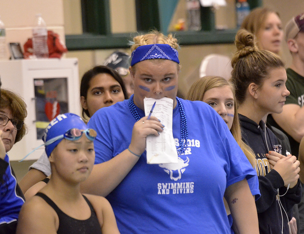 . Shaker High School swim coach Maggie Callesano looks up anxiously at the scoreboard during the Section 2 Division I championship meet at Shenendehowa.