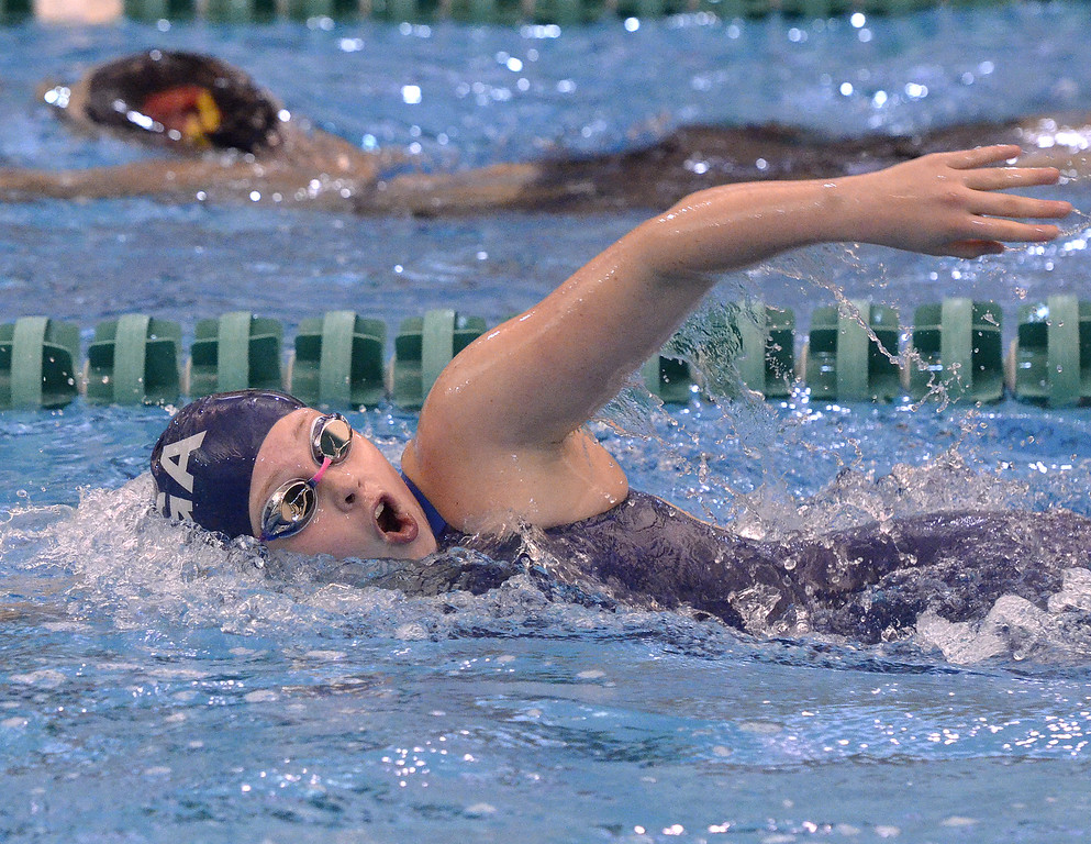 . Saratoga Springs freshman Aileen Klaus turns her head out of the water during the first heat of the 500-yard freestyle Saturday at the Shenendehowa Aquatics Center.
