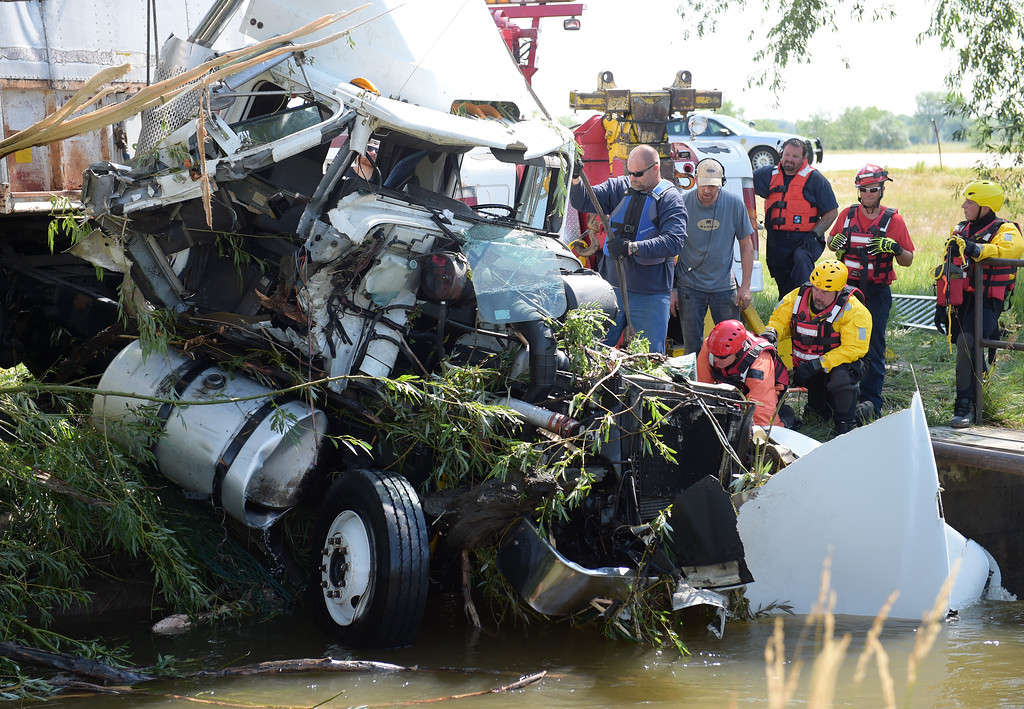 . The semi tractor trailer which crashed into the Highland Ditch along U.S. 287 north of Longmont Thursday evening is removed from the ditch Friday morning. Lewis Geyer/Staff Photographer July 07, 2017