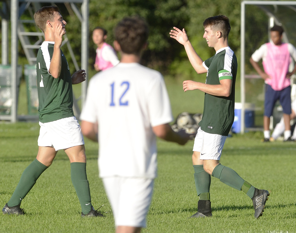 . STAN HUDY - SHUDY@DIGITALFIRSTMEDIA.COMShenendeowa senior captain Ethan Brunell (right) looks to celebrate his second goal with teammate Eric Makhatadze late in the second half against Shaker High Thursday afternoon on the Shenendehowa campus.