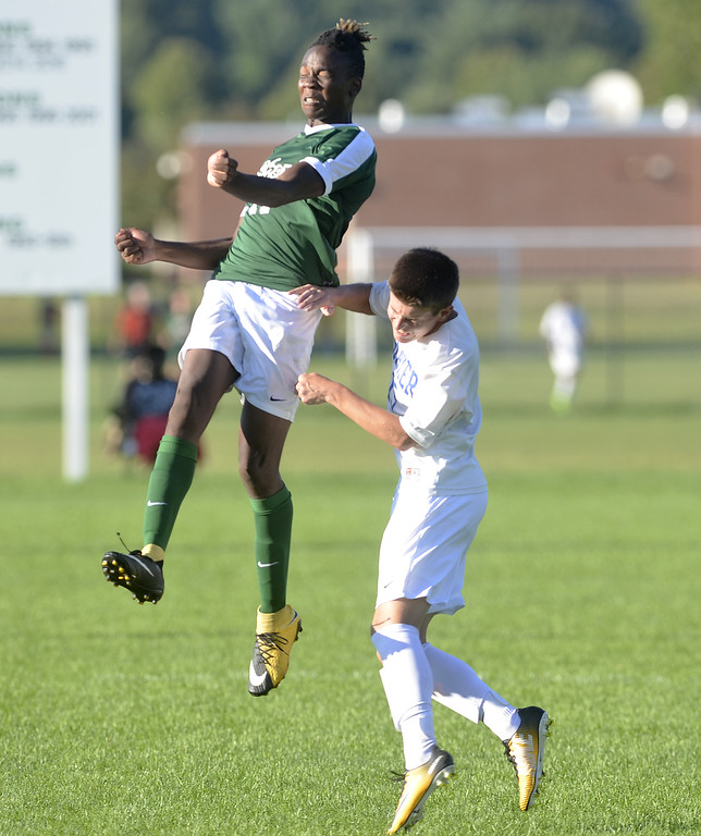 . STAN HUDY - SHUDY@DIGITALFIRSTMEDIA.COMShenendehowa junior Jaylin Sykes leaps up to had the ball against Shaker High Thursday afternoon on the Shenendehowa campus.