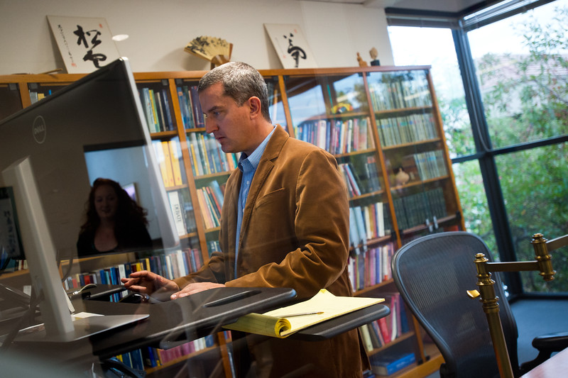 "President Nikko Odiseos works on his computer at Shambhala Publications on Friday. Shambhala Publications is the world's largest English-language Buddhist book publishing company, and is celebrating its one-year anniversary in Boulder. <br /> More photos:  <a href=""http://www.dailycamera.com"">http://www.dailycamera.com</a><br /> (Autumn Parry/Staff Photographer)<br /> September 30, 2016"