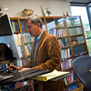 """President Nikko Odiseos works on his computer at Shambhala Publications on Friday. Shambhala Publications is the world's largest English-language Buddhist book publishing company, and is celebrating its one-year anniversary in Boulder. <br /> More photos:  <a href=""""http://www.dailycamera.com"""">http://www.dailycamera.com</a><br /> (Autumn Parry/Staff Photographer)<br /> September 30, 2016"""