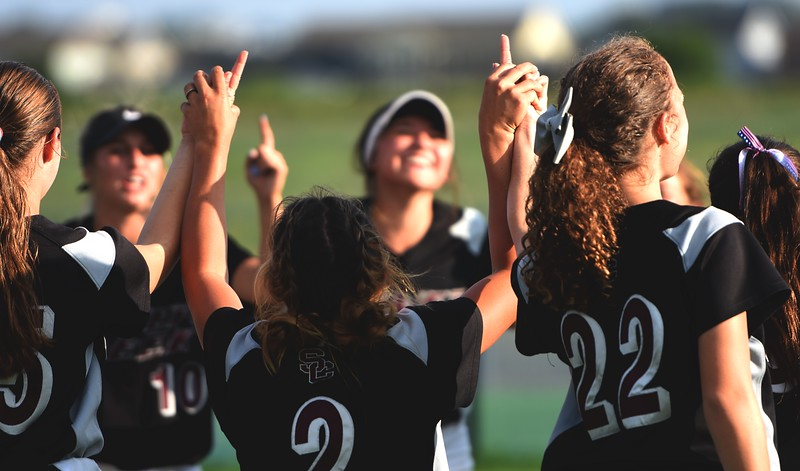The Silver Creek softball team celebrates with a dance party in right after after beating Mountain View, 6-4, on Tuesday at Mountain View High School in Loveland.