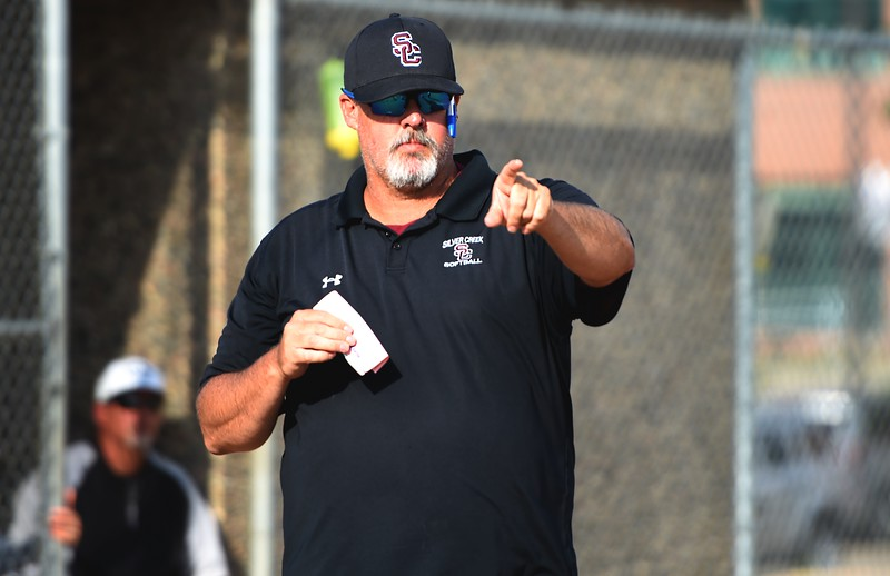 Silver Creek head coach Ryan Beavers calls for a pinch hitter during the Raptors' game against Mountain View on Tuesday at Mountain View High School in Loveland.