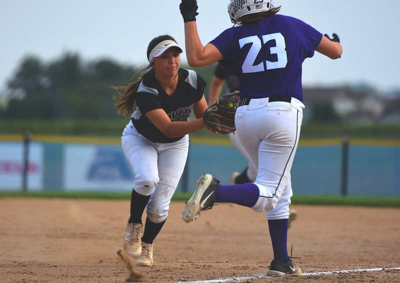 Silver Creek first baseman Makayla Garcia tags a runner out during the Raptors' game against Mountain View on Tuesday at Mountain View High School in Loveland.