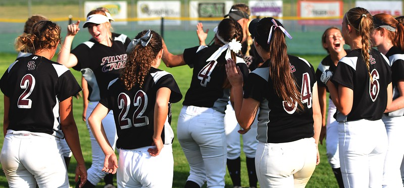 The Silver Creek softball team celebrates a 6-4 victory over Mountain View with a dance party in right field on Tuesday at Mountain View High School in Loveland.