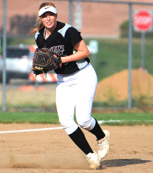 Silver Creek third baseman Lucy Scott lines up a throw to first during the Raptors' game against Mountain View on Tuesday at Mountain View High School in Loveland.