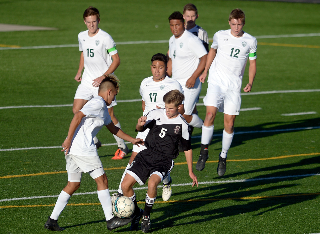 . Niwot\'s Jason Rodriguez and Silver Creek\'s Simon Gerlach battle for the ball in the the first half Tuesday evening at Erie High School. Niwot won 2-1. To view more photos visit bocopreps.com. Lewis Geyer/Staff Photographer Oct. 10, 62017