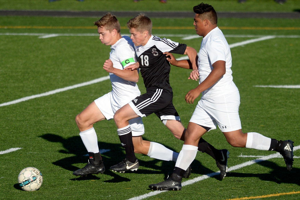 . Silver Creek\'s Trey Gerlach is caught between Niwot\'s Cameron Carlson and Abel Marrufo in the first half Tuesday evening at Erie High School. Niwot won 2-1. To view more photos visit bocopreps.com. Lewis Geyer/Staff Photographer Oct. 10, 62017