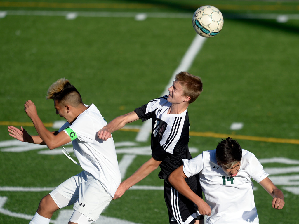 . Niwot\'s Jason Rodriguez and Andres Montealegre battle for the ball against Silver Creek\'s Jacob Van Ens Tuesday evening at Erie High School. Niwot won 2-1. To view more photos visit bocopreps.com. Lewis Geyer/Staff Photographer Oct. 10, 62017