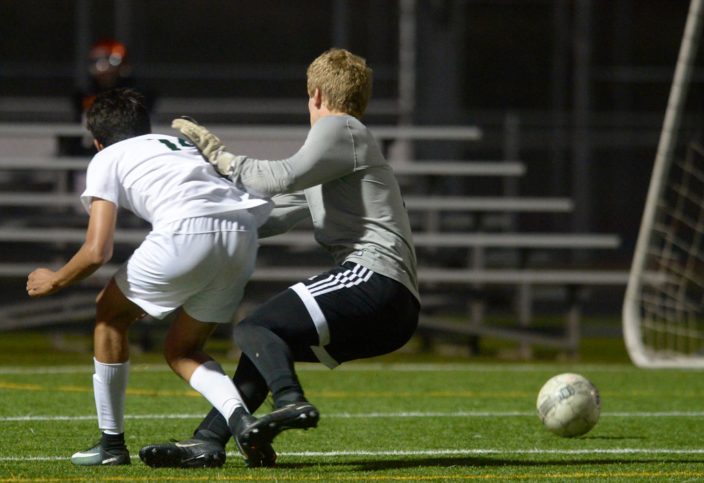 . Niwot\'s Manuel Tapia slips the ball past Silver Creek goal keeper Brandon Coder in overtime for the game-winning goal Tuesday evening at Erie High School. Niwot won 2-1. To view more photos visit bocopreps.com. Lewis Geyer/Staff Photographer Oct. 10, 62017