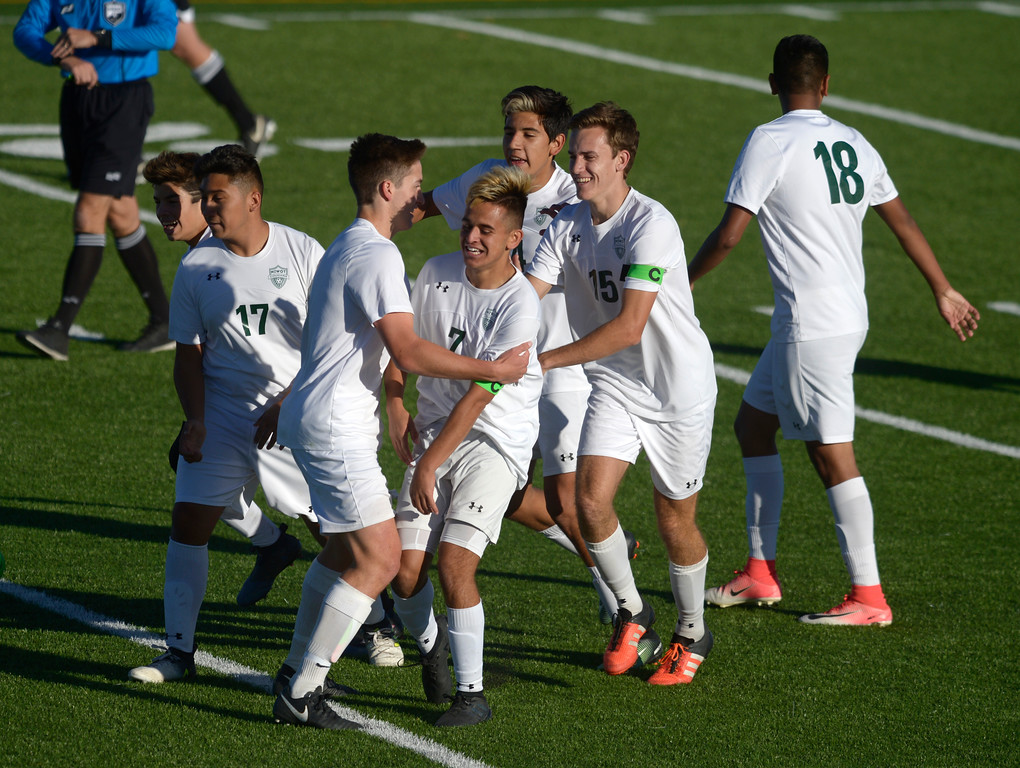 . Niwot\'s Jason Rodriguez, 7, is surrounded by teammates after scoring a goal in the first half against Silver Creek Tuesday evening at Erie High School. Niwot won 2-1. To view more photos visit bocopreps.com. Lewis Geyer/Staff Photographer Oct. 10, 62017