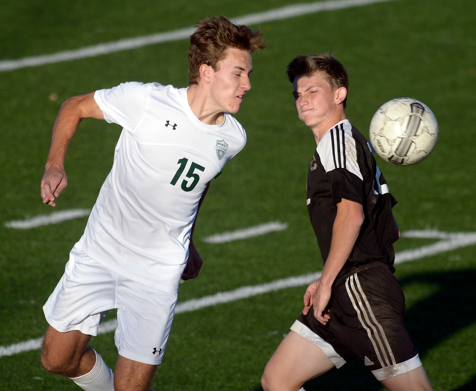 . Niwot\'s Nicholas Grant heads the ball next to Silver Creek\'s Connor Peskin in the first half Tuesday evening at Erie High School. Niwot won 2-1. To view more photos visit bocopreps.com. Lewis Geyer/Staff Photographer Oct. 10, 62017