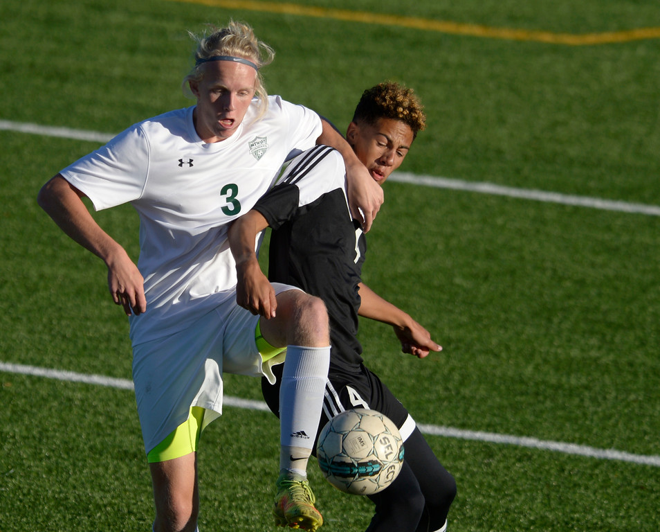 . Niwot\'s Magnus Hansen and Silver Creek\'s Aven Risk get tangled in the first half Tuesday evening at Erie High School. Niwot won 2-1. To view more photos visit bocopreps.com. Lewis Geyer/Staff Photographer Oct. 10, 62017